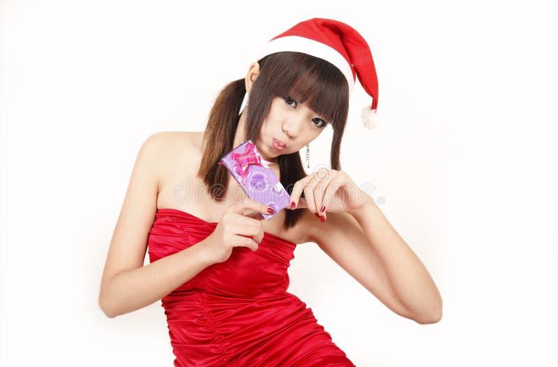 Menina do Natal com seu presente fotos de stock