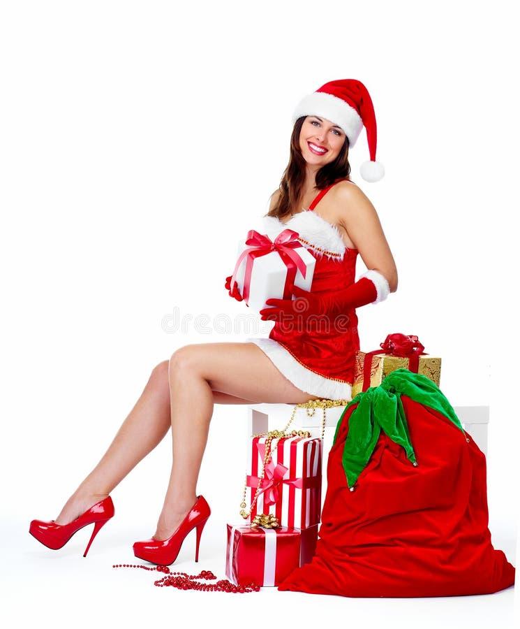Menina do Natal do ajudante de Santa com presentes. imagens de stock
