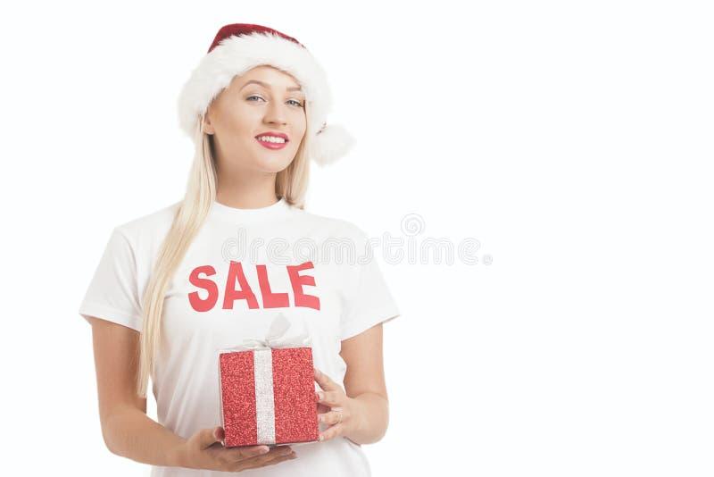 menina do Natal no chapéu do ` s de Santa com presente fotos de stock royalty free
