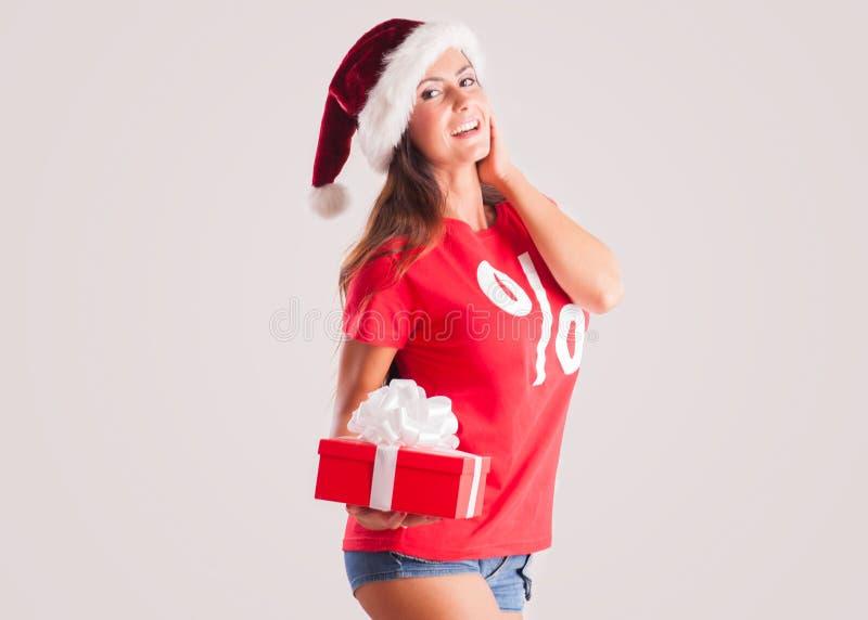 Menina do Natal no chapéu do ` s de Santa com soldado foto de stock