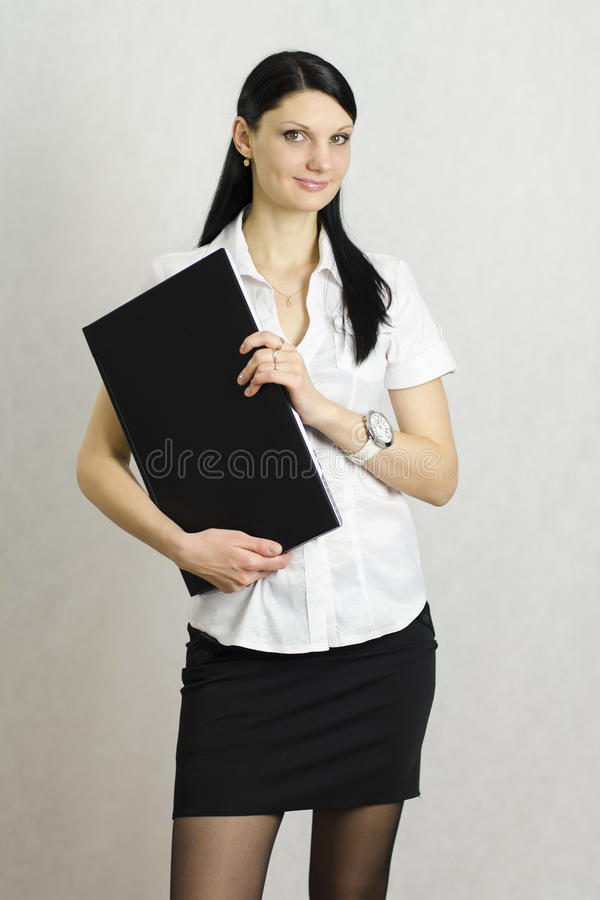 Menina do negócio com um portátil fotos de stock royalty free
