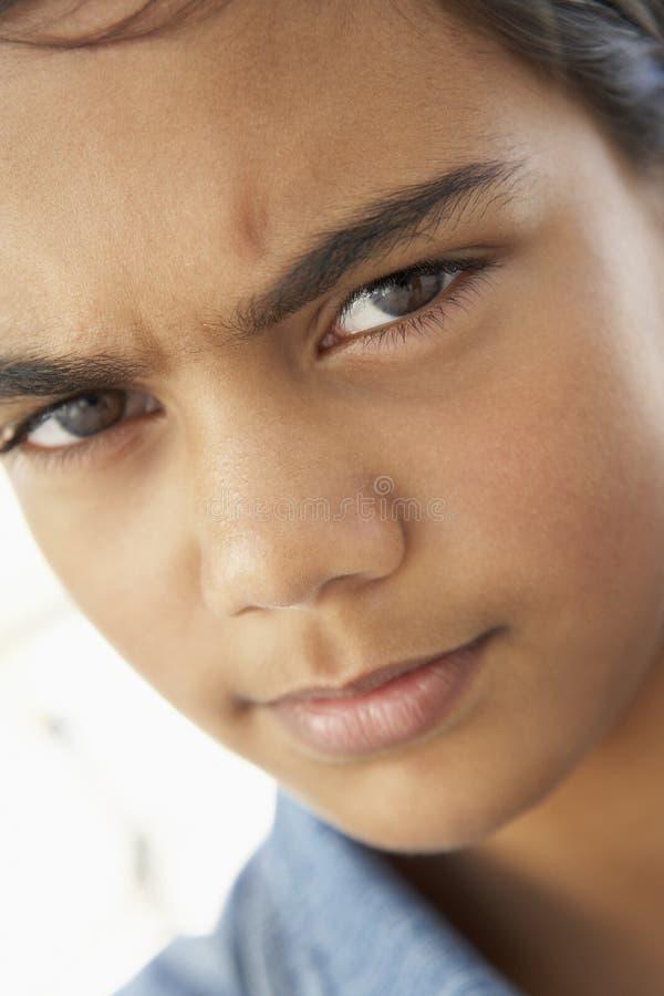 Menina do Pre-Teen que olha de sobrancelhas franzidas fotos de stock