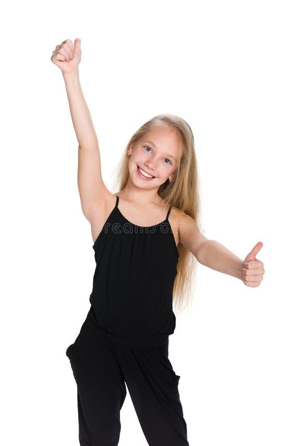 A menina do Preteen mantém seus polegares fotos de stock royalty free