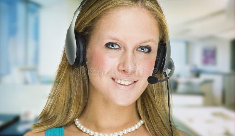 Menina do serviço de atenção a o cliente imagem de stock