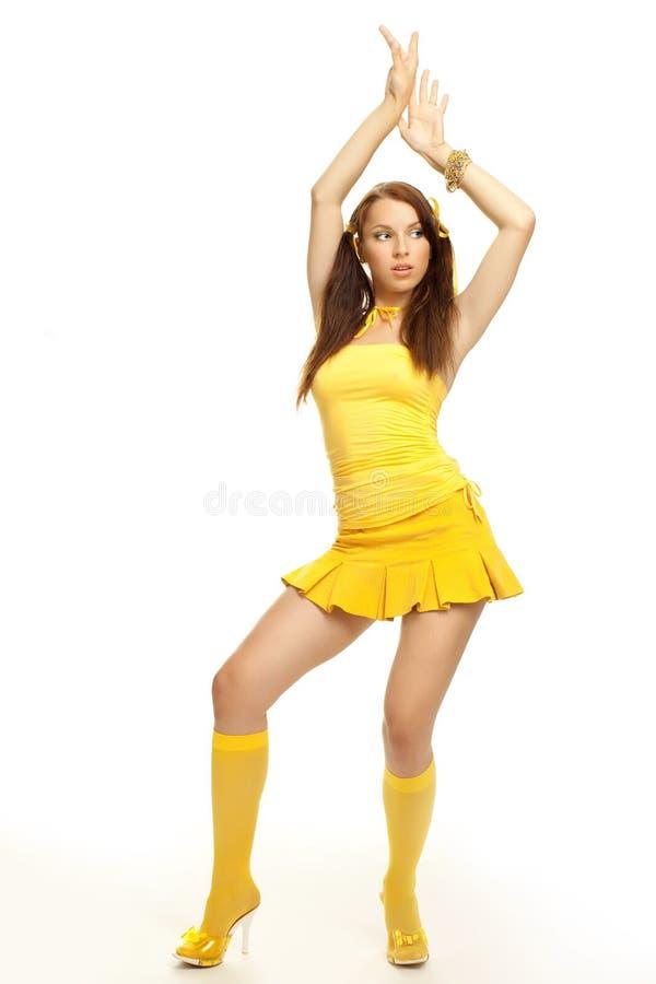 Menina do sexo em um vestido amarelo foto de stock royalty free