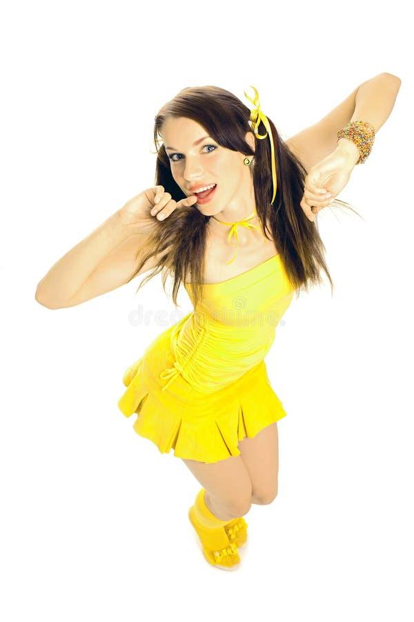 Menina do sexo em um vestido amarelo imagens de stock royalty free