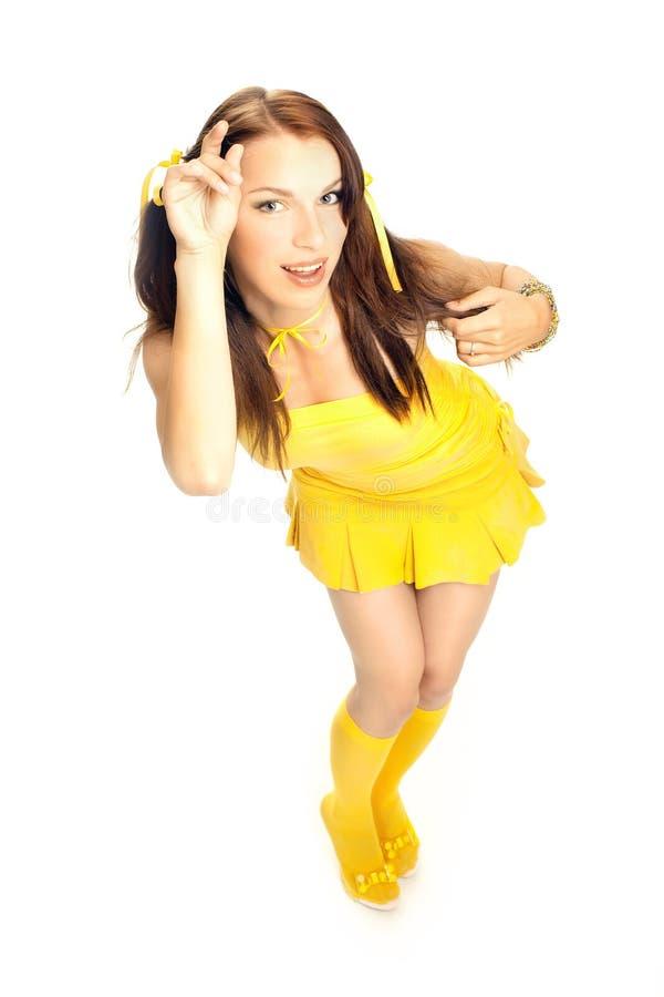 Menina do sexo em um vestido amarelo fotografia de stock