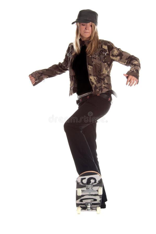 Menina do skater imagens de stock