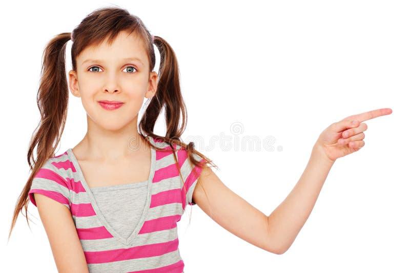 Menina do smiley que aponta em algo fotografia de stock royalty free