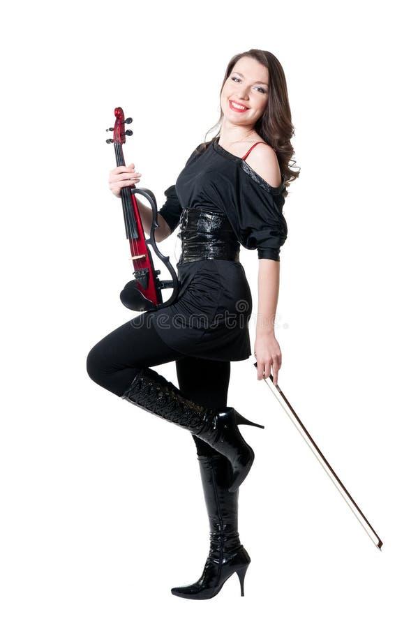 Menina do violinista no vestido preto fotos de stock royalty free