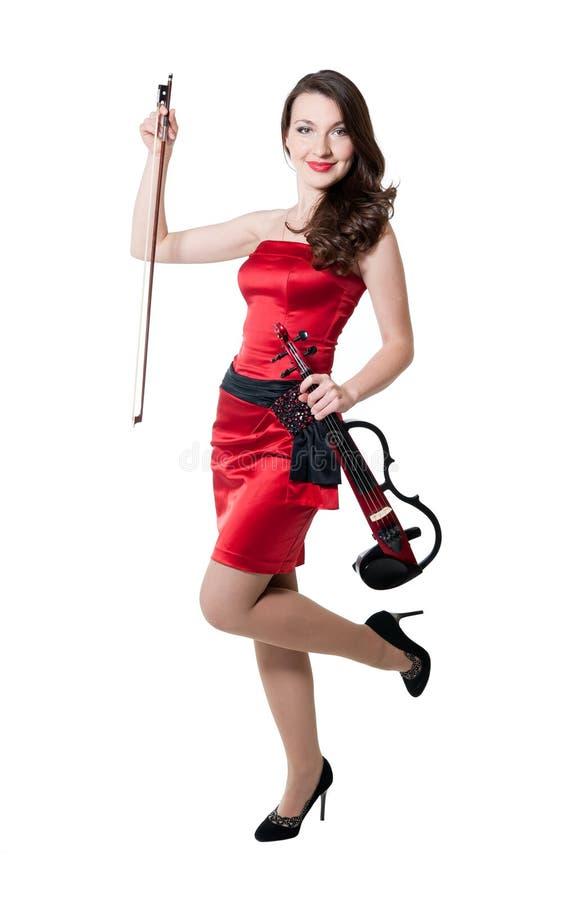 Menina do violinista no vestido vermelho foto de stock