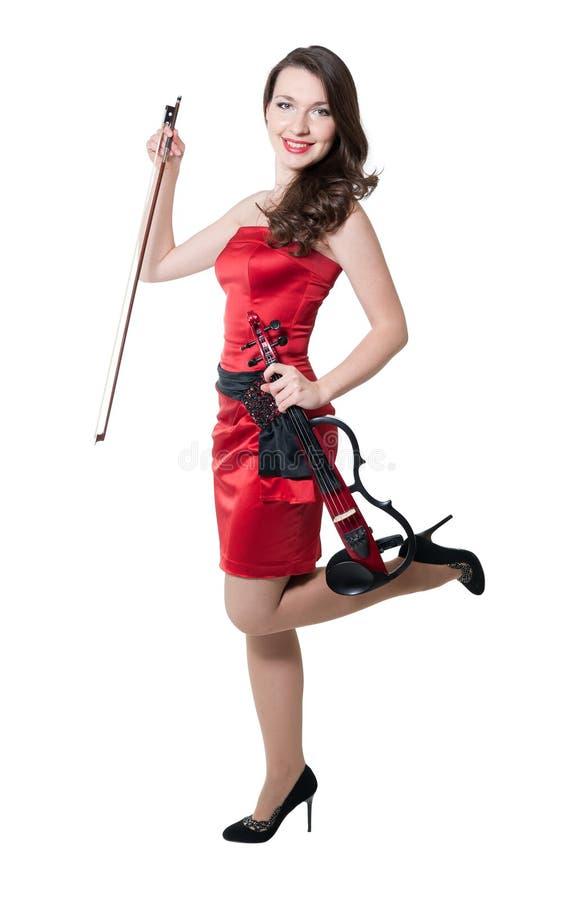Menina do violinista no vestido vermelho imagens de stock royalty free