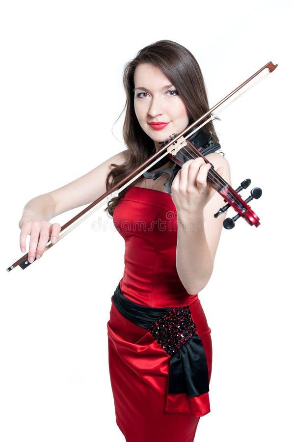 Menina do violinista no vestido vermelho fotografia de stock royalty free