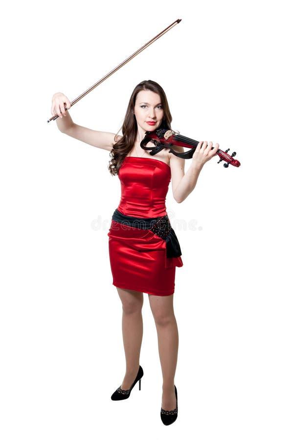 Menina do violinista no vestido vermelho fotos de stock royalty free