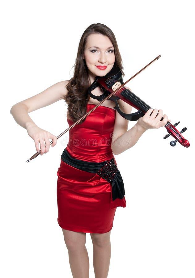 Menina do violinista no vestido vermelho fotos de stock