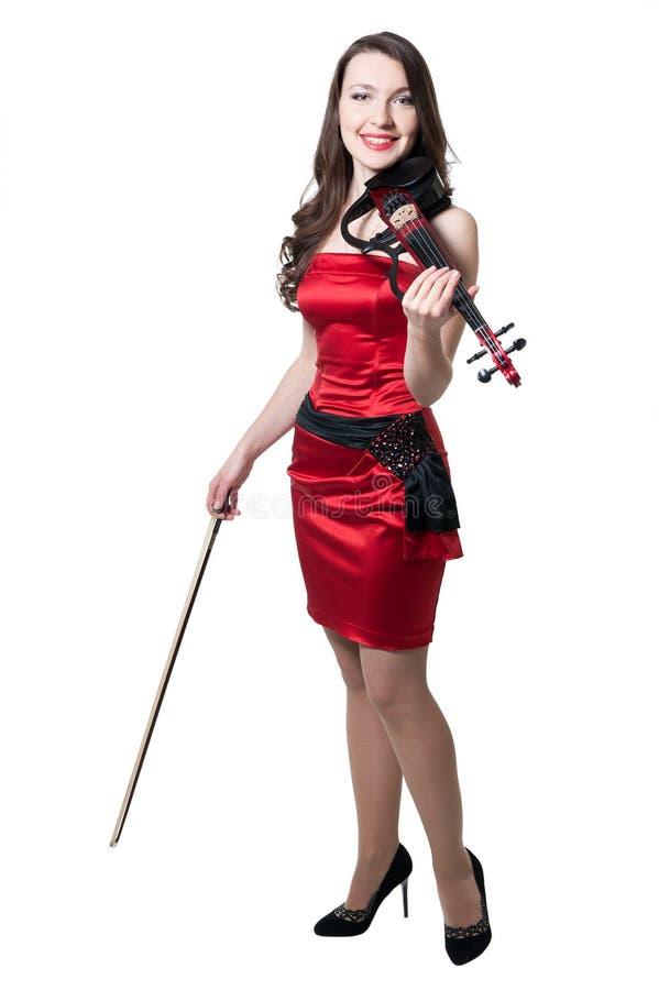 Menina do violinista no vestido vermelho foto de stock royalty free