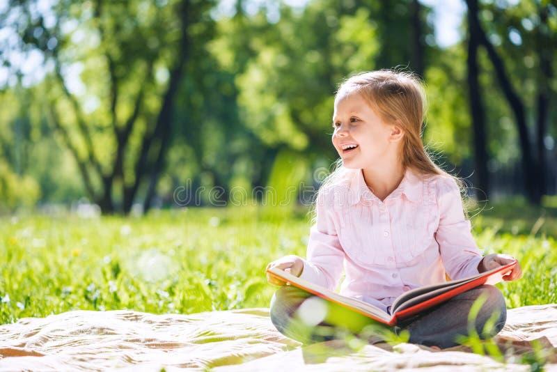 Menina doce no parque fotografia de stock royalty free