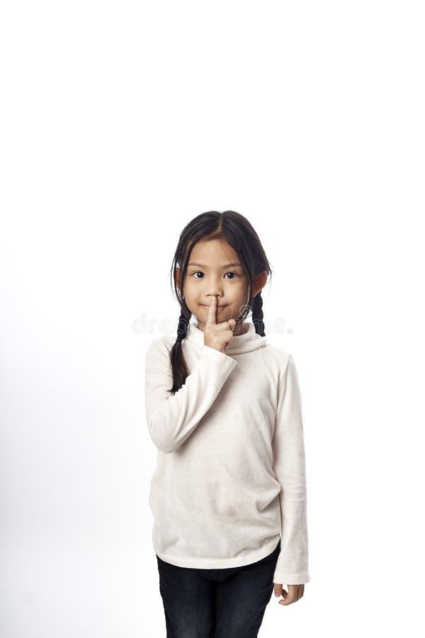 Menina doce que faz caretas imagem de stock royalty free