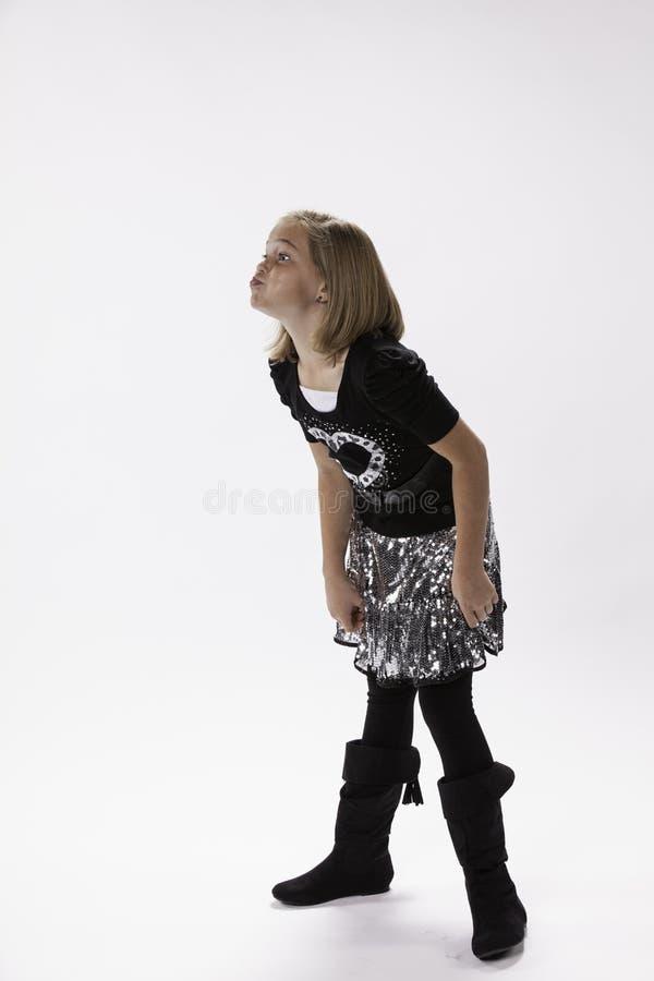 Menina dos anos de idade 10 com os bordos para fora pooched fotos de stock royalty free