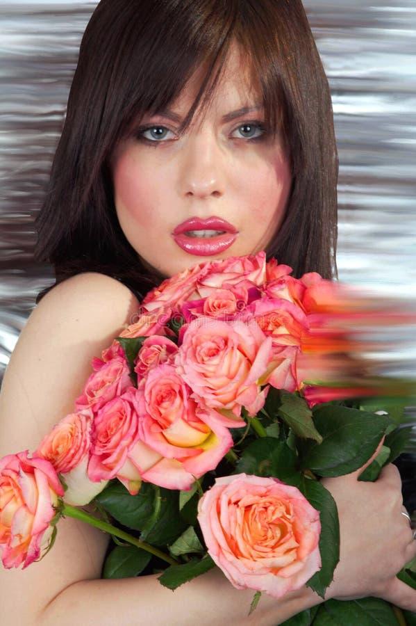 A menina e as rosas foto de stock royalty free