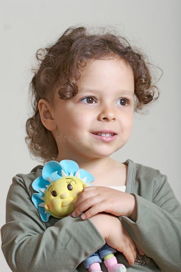 Menina e boneca foto de stock