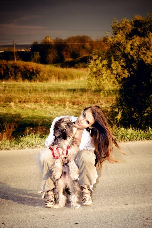 Menina e cão fotografia de stock royalty free