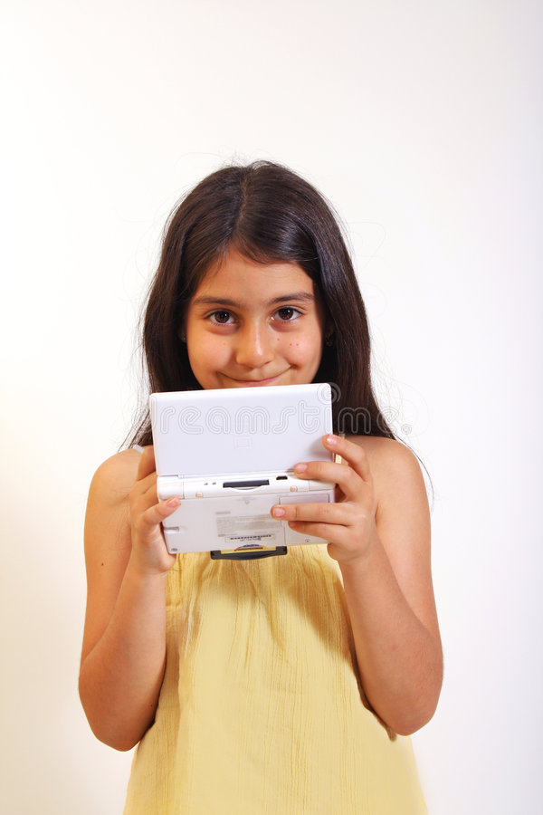 Menina e jogos video fotografia de stock