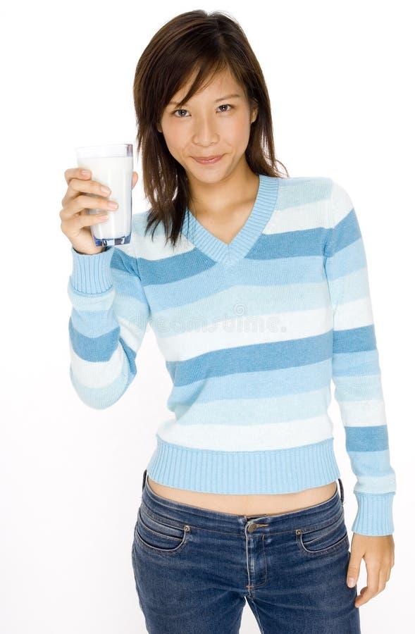 Menina e leite foto de stock royalty free