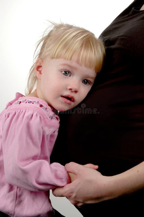 Menina e matriz grávida fotografia de stock
