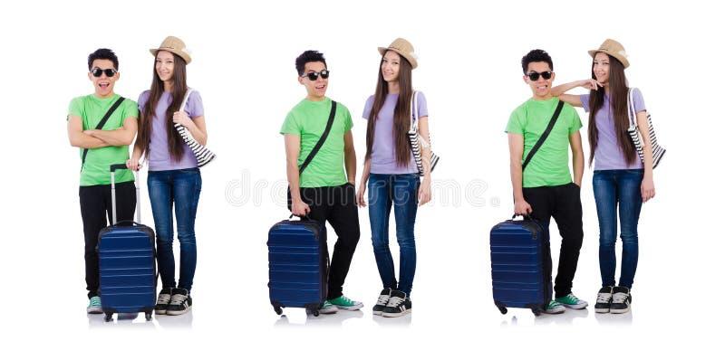 Menina e menino com a mala de viagem isolada no branco foto de stock