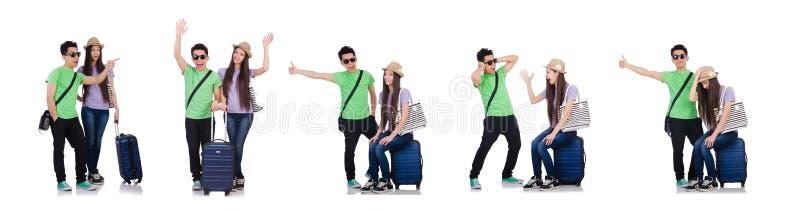 Menina e menino com a mala de viagem isolada no branco foto de stock royalty free