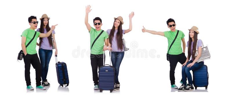 Menina e menino com a mala de viagem isolada no branco fotografia de stock