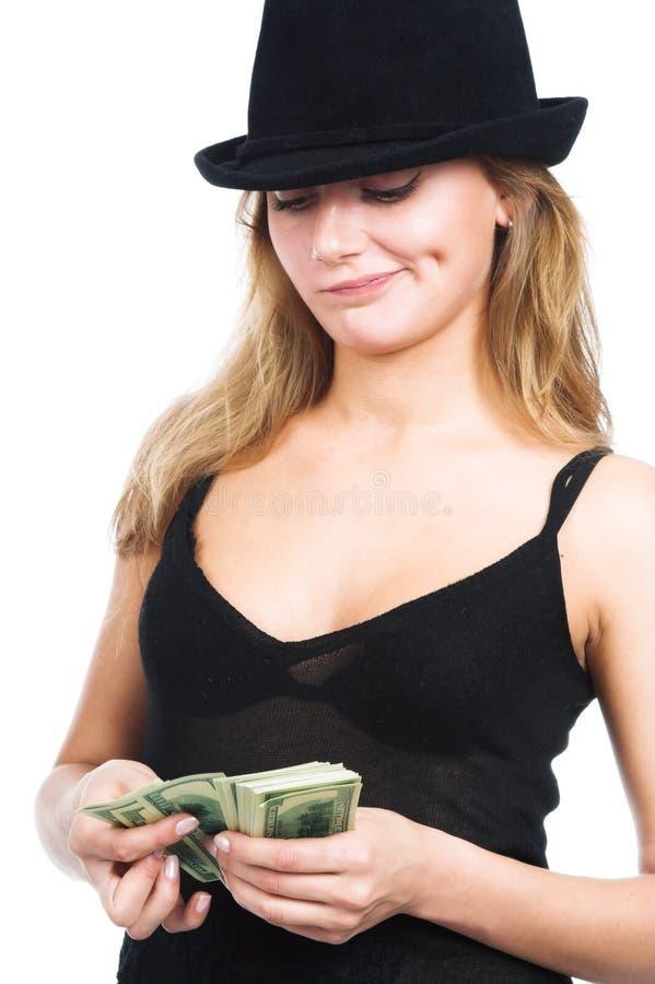 A menina e o dinheiro fotos de stock