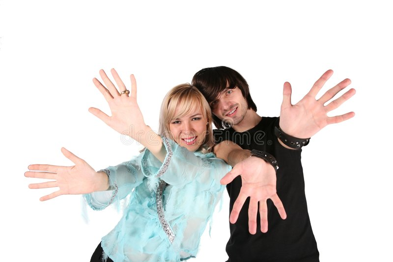 A menina e o menino mostram gestos pelas mãos fotografia de stock