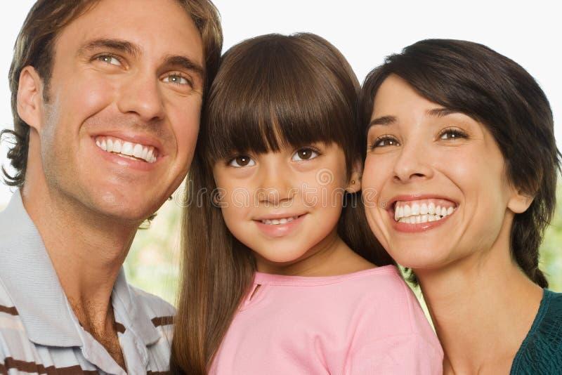 Menina e pais felizes fotografia de stock royalty free
