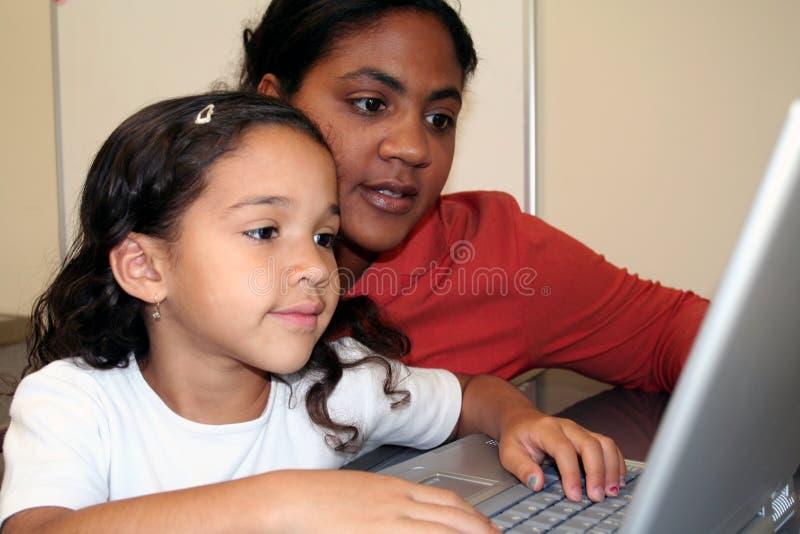 Menina e professor imagem de stock royalty free