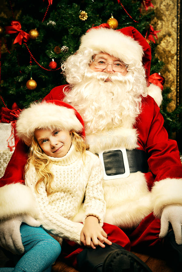 Menina e Santa Claus fotografia de stock royalty free