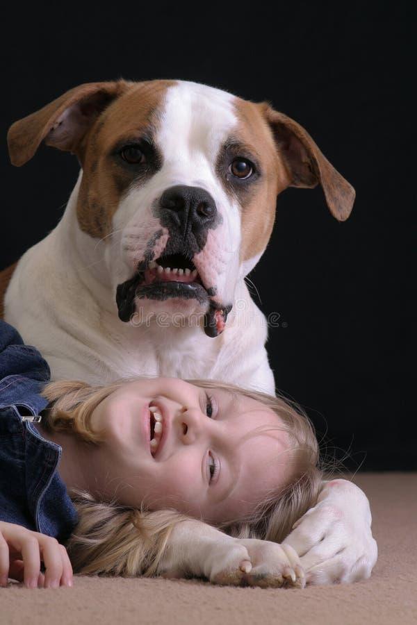Menina e seu cão foto de stock royalty free