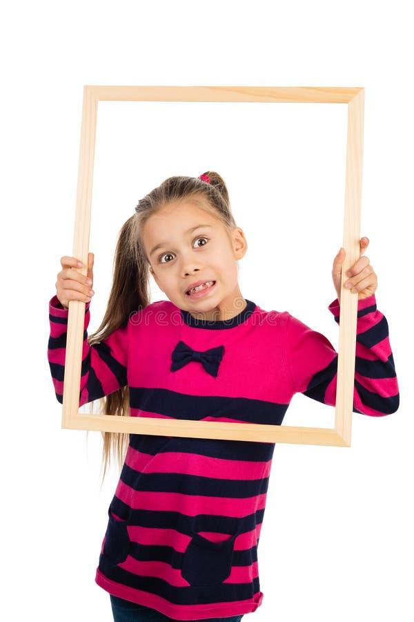 Menina e um quadro fotos de stock