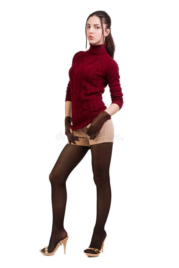 Menina elegante no vermelho sobre o branco fotografia de stock