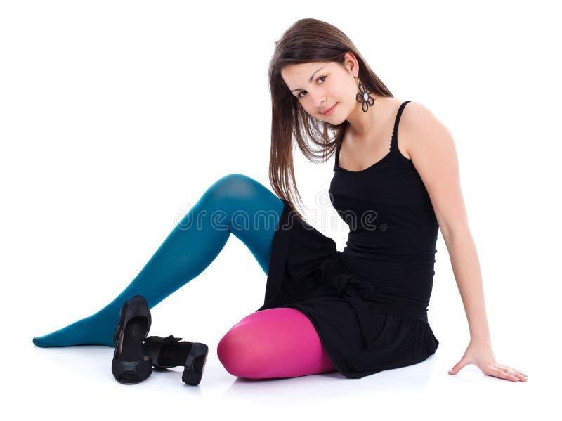 Menina em calças justas coloridas diferentes fotografia de stock royalty free