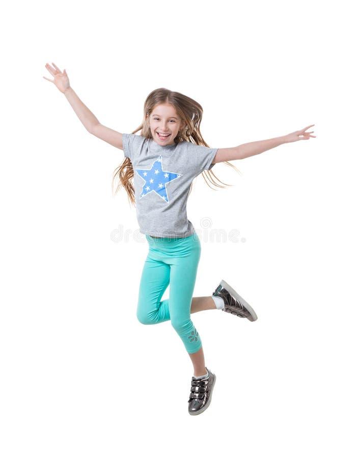 Menina em caneleiras verdes, dança, isolada fotos de stock