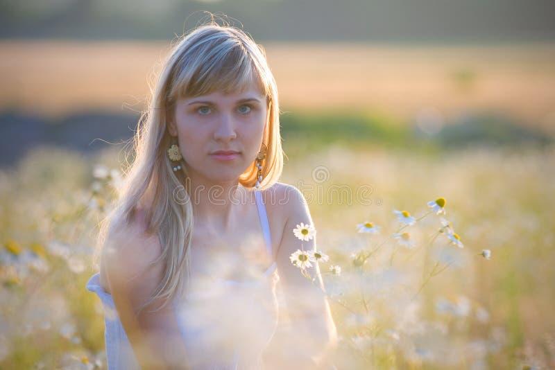 Menina em flores de Camilo imagens de stock royalty free