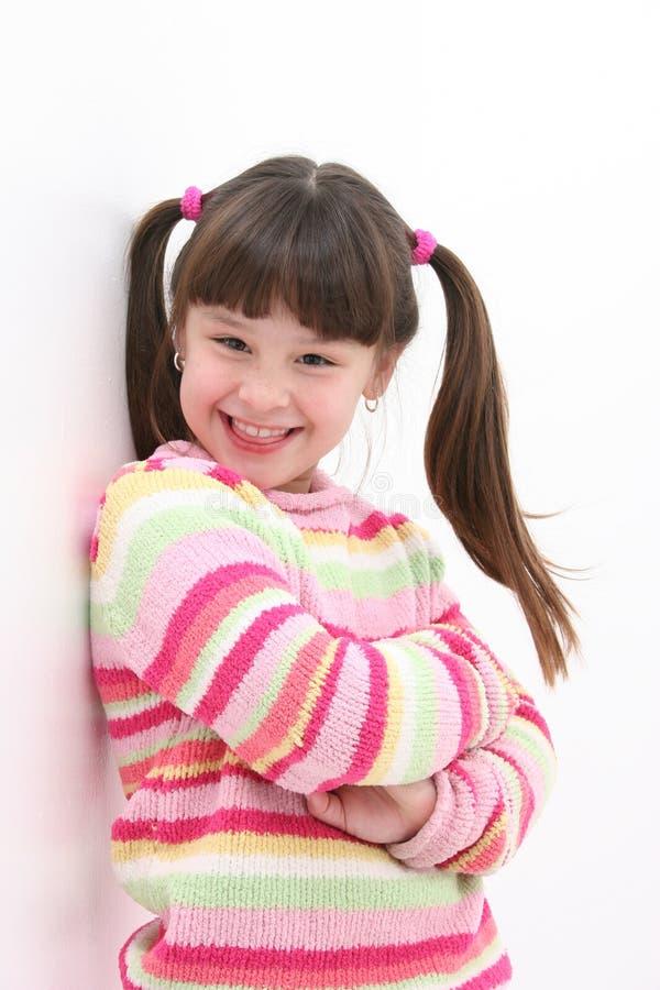 Menina em listras cor-de-rosa fotos de stock royalty free