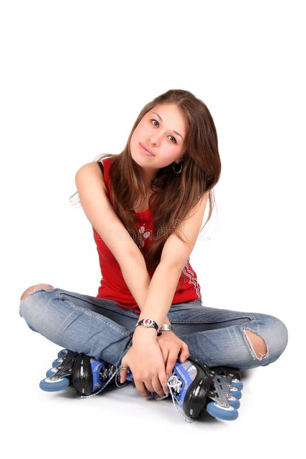 Menina em patins de rolo imagens de stock