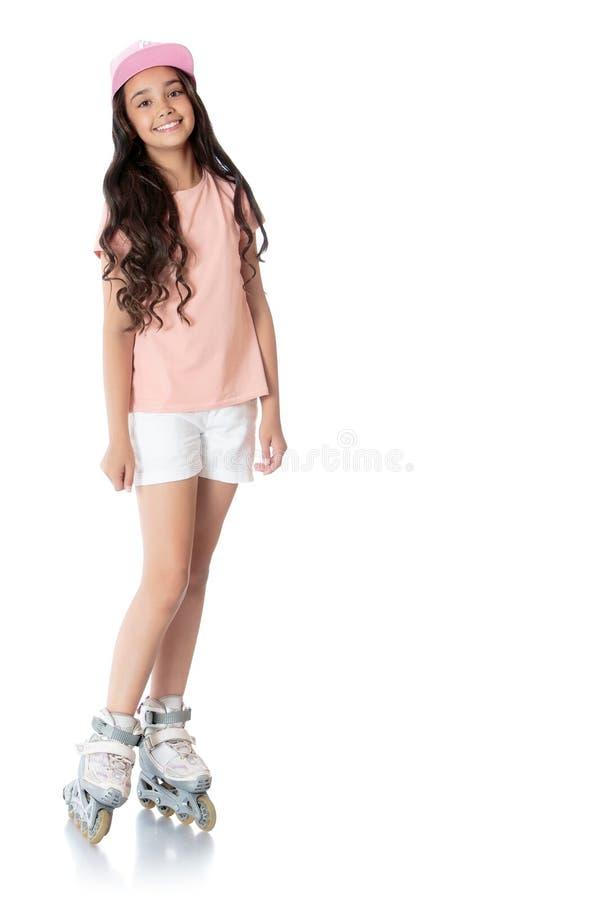 Menina em patins de rolo imagens de stock royalty free