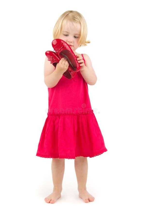 Menina em sapatas vermelhas fotos de stock