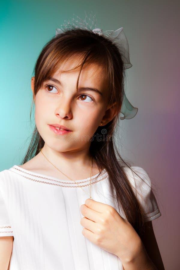 Download Menina Em Seu Primeiro Dia Do Comunhão Imagem de Stock - Imagem de communion, infância: 26500309