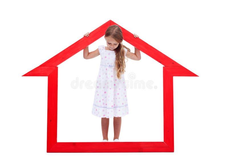 Menina em sua casa imagens de stock