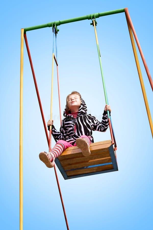 Menina em um balanço fotografia de stock royalty free